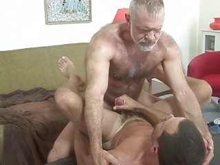 mature gay dad bangs younger stud on table