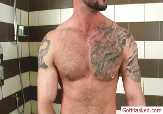 muscled and pierced hunk playing