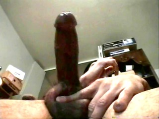 dude massaging his large schlong
