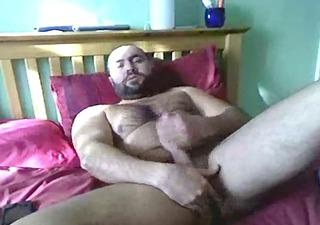 hairy fellow jerks off in ottoman