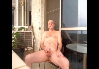 jerking off nude on balcony