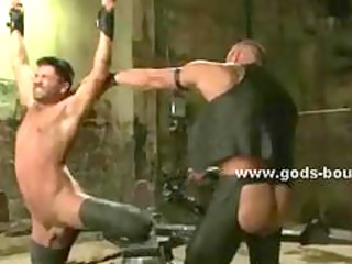 angry homosexual hunk tied in chains depraved in