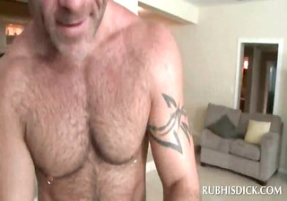 mad gay masseur rubbing his clients dong with oil