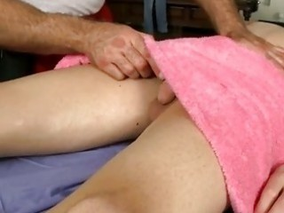 muscle homo man gives boy a massage and a cook