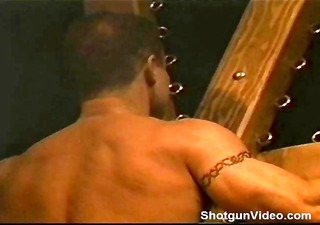 muscle man on st andrews cross flogged by his